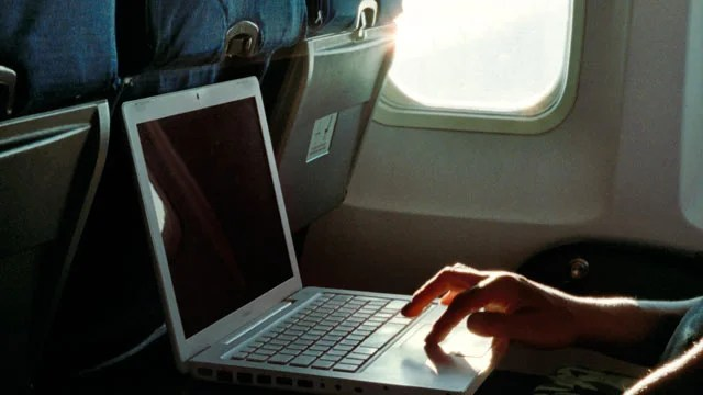 on board with a laptop