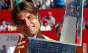 Spain's David Ferrer holds the trophy after winning the Buenos Aires Open men's single tennis match against Switzerland's Stanislas Wawrinka at the Buenos Aires Lawn Tennis Club