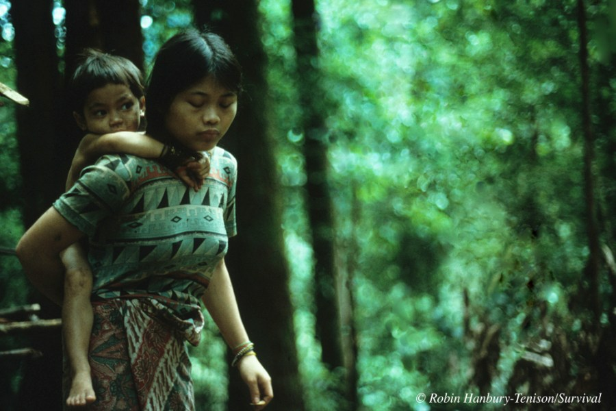 Penan mother and child in the forest, Sarawak, Malaysia.