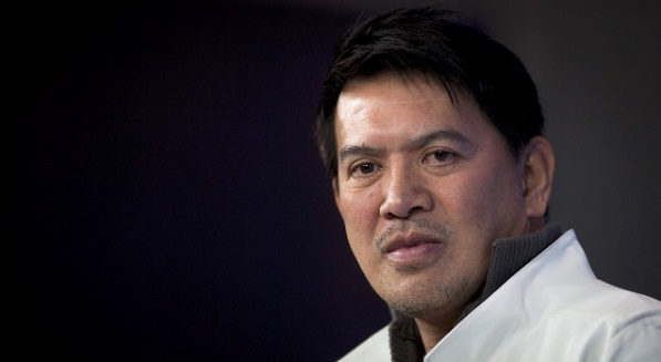 "Director Brillante Mendoza poses during a photocall to promote his movie ""Captive"" at the 62nd Berlinale International Film Festival in Berlin February 12, 2012. REUTERS/Thomas Peter (GERMANY - Tags: ENTERTAINMENT HEADSHOT)"