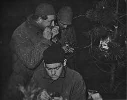 Ringing of common starlings in the middle of the night near the Hague in 1931. From front to back: dr. K. Waldeck, dr. J.C. Koch (not eating the starling but closing the ring with his teeth) and J.P. Bouma. Photo: F.P.J. Kooijmans.