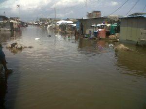 A flooded street at the Okun Alfa community