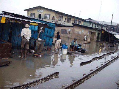 No train in sight rev up a wet and gloomy rail line community at Agege, Lagos