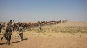Photos posted online appeared to show dozens of men being marched through the desert