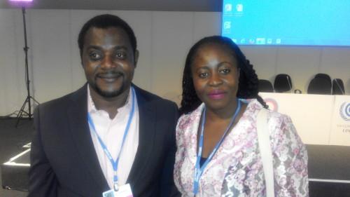 James Chidi Okeuhie (left) with Chioma Amudi (Senior Scientific Officer, DCC)  Nigeria commissions Ricardo-AEA to prepare INDCs IMG 20141208 181614 e1435889091448