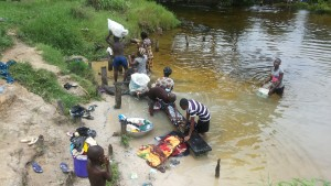 Performing domestic chores by the Nkisa River in Ebocha. Photo credit: Dandy Mgbenwa