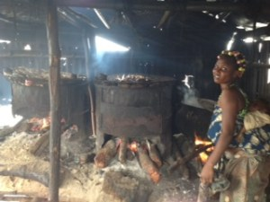 Mother and baby at risk from smoke poisoning as mother processes fresh fish at  SagboKodji Island