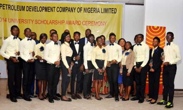 General Manager External Relations, Shell Petroleum Development Company of Nigeria JV, Igo Weli (back row right), parents and top 15 beneficiaries of the 2013/2014 SPDC JV University Scholarship award in Port Harcourt recently.