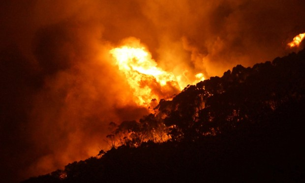 A wildfire burns out of control on Christmas Day in Victoria state, Australia. Photo credit: Keith Pakenham/AFP/Getty Images  Scientists link UK floods, extreme global weather to El Nino, climate change Fire