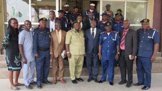 Controller General of Prisons, Dr Peter Ezenwa Ekpendu (fifth right); DG/CEO of the National Biosafety Management Agency (NBMA), Sir. Rufus Ebegba (fourth right); Commandant General of the Nigerian Security and Civil Defence Corps (NSCDC), Abdullahi Muhammadu (third right); Coordinator of Journalists for Social Development Initiative (JSDI), Etta Michael Bisong (second left); and Head of Programmes of JSDI, Gloria Ogbaki, during a familiarity visit to the corporate head office of the NSCDC in Abuja to foster collaboration on the enforcement of the National Biosafety Management Act