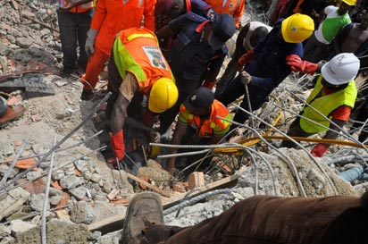Rescue workers at the building collapse site