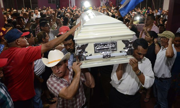 Relatives and friends carry the coffin of murdered indigenous activist Berta Cáceres. Around the world in 2014, the killings averaged two a week, according to Global Witness. Photo credit: Orlando Sierra/AFP/Getty Images