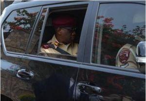 Oyeyemi Boboye, FRSC Corps Marshal, at the rear seat using a safety belt