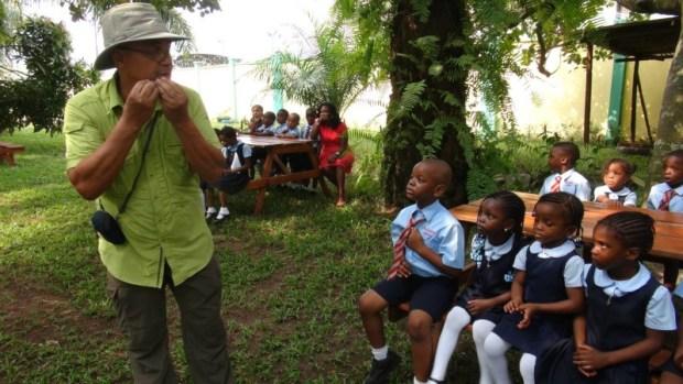 Desmond Majekodunmi with visiting school children at the LUFASI Nature Park
