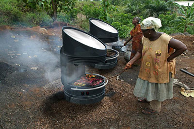 A solar grill stove in use