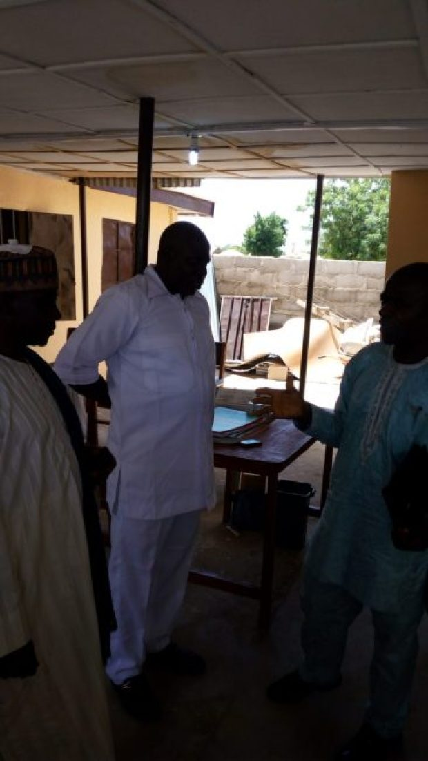 Okon Ekpenyong, an engineer and deputy director with the ECN (right) sharing a point with Mallam Ja'afaru Biyma (left) and Javan Zakaria  Images: Solar brightens insurgency-hit villages in Adamawa IMG 20160621 120456 e1466874774504