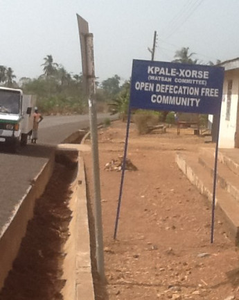 A sign post displaying the ODF status of the community  Divine principles inspire Ghanaian community's open-defecation-free status Kpale
