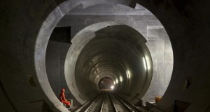 The tunnel will curb emission as it is expected to get some 600,000 trucks off the road every year. Photo credit: Picture-alliance/Keystone/M. Ruetschi  World's longest rail tunnel opens in Switzerland Tunnel 300x161