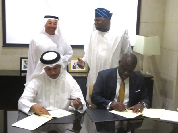 Lagos State Attorney-General and Commissioner of Justice, Adeniji Kazeem, and the Chief Executive Officer of Smart City Dubai LLC, Jabber Bin Hafez signing the MoU, in the presence of Chairman of Dubai Holdings, Ahmad Bin Byat, who is also the Deputy Prime Minister and the Lagos State Governor, Akinwunmi Ambode