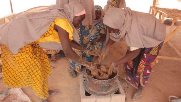 IDP women molding a stove