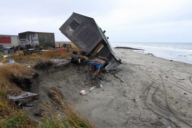The remote village of Shishmaref, Alaska, has been experiencing the effects of climate change first-hand. In the last decades, the island's shores have been eroding into the sea, falling off in giant chunks whenever a big storm hits. Photo credit:: Gabriel Bouys/AFP/Getty Images