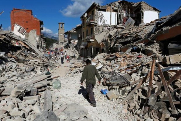 A man walks amid the rubble in Pescara del Tronto. Photo credit: Remo Casilli / Reuters  Images: Devastating quake rattles central Italy Italy7 e1472099680611