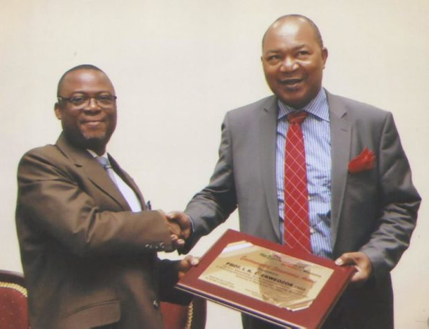 The Vice Chancellor, University of Port Harcourt, Professor Ndowa Lale presents an award to Professor I. K. E. Ekweozor of the River State University of Science and Technology Port Harcourt