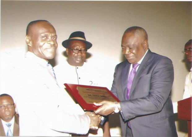 Dr. Daru Owei, former DMD of Agip receives an award from the Director-General of NESREA, Dr. Lawrence Anukam while Publisher of the Environment Outreach Magazine admires