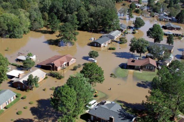 US-flood  White House calls climate change research a 'waste' US climate e1490300421924