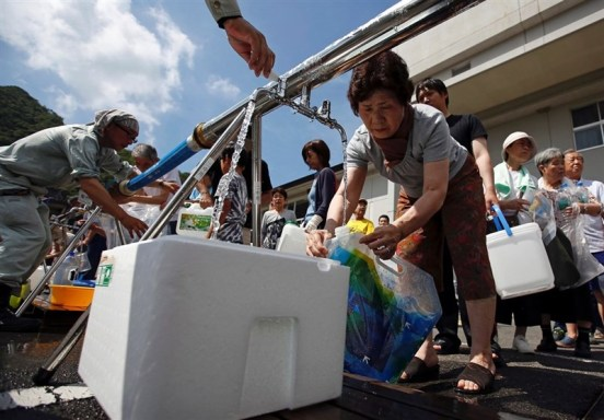 Japan  Japan struggles to restore water to flood-hit towns Japan fix watrer problem after flooding