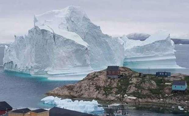 greenland-iceberg  Huge iceberg drifts close to Greenland village, causing fears of a tsunami greenland iceberg