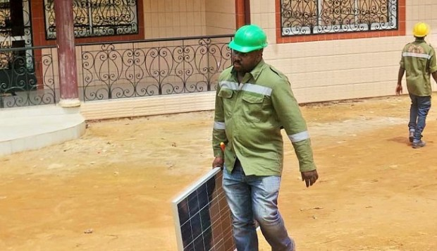 Gaston Claude Songo about to install solar panels