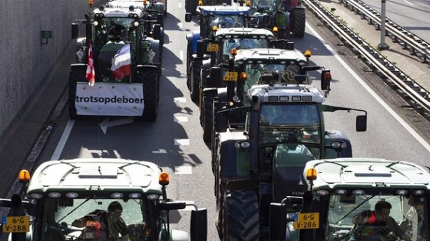 Dutch farmers  Dutch farmers angered by environmental regulations, block streets Dutch farmers