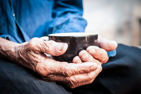 old-hands-holding-coffee