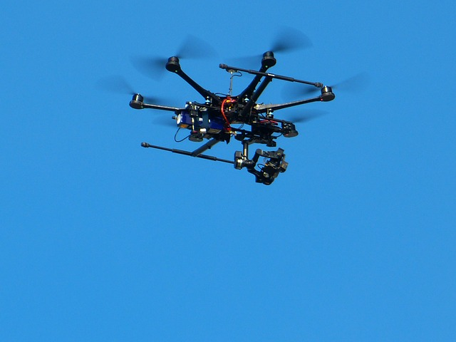 Drone hexacopter flying against a blue sky