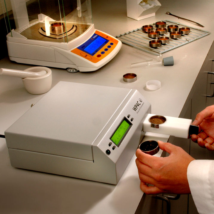 Image of a researcher using a WP4C Dew Point Hygrometer to test a sample