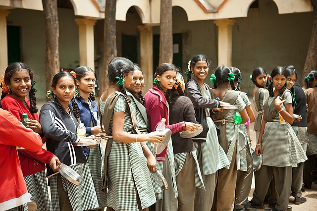 Smiling students standing in a huge line
