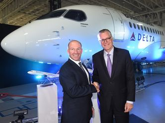 Alain Bellemare, left, president and CEO of Bombardier Inc., and Ed Bastian, right, CEO of Delta Air Lines, shake hands in front of a Delta-branded Bombardier C-Series jet in Mirabel, Que., on Thursday, April 28, 2016. Bombardier received a major boost Thursday from Delta Air Lines, which has placed a firm order for 75 CS100 aircraft with options for an additional 50 more in what would be the largest order for the Montreal company's troubled CSeries passenger jet program. THE CANADIAN PRESS/Ryan Remiorz