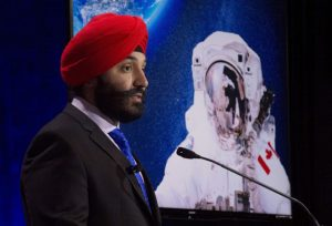 """Innovation minister Bains announcing an open call for two new astronauts at the Canadian Aviation and Space Museum on Friday, June 17th. As outlined in the June 17th, 2016 Canadian Press article, """"Canadian Space Agency seeks polite astronauts to join space program,""""  applications for two new astronaut openings are being accepted until Aug. 15th, and """"the more stereotypically Canadian the astronaut-hopefuls are, the better."""" For a more formal perspective on the application process, check out the CSA web page on astronaut recruitment. Photo c/o Adrian Wyld / Canadian Press."""