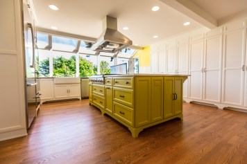 Accent kitchen island and stained oak hardwood floors