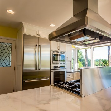 Calcutta marble slab island kitchen counter