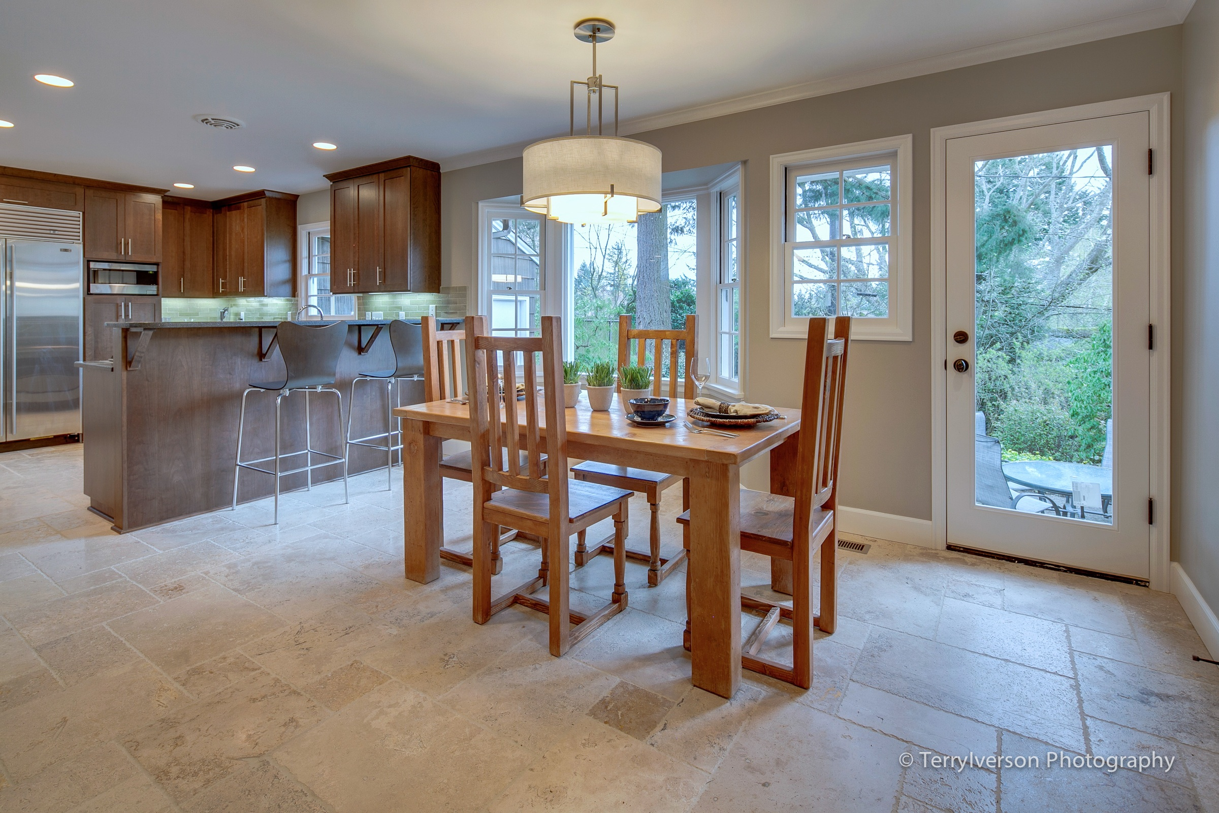 Dining room with patterned travertine tile floor  Envision Interiors