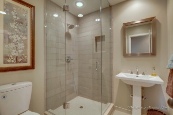 Guest bath with hand crafted ceramic tile shower