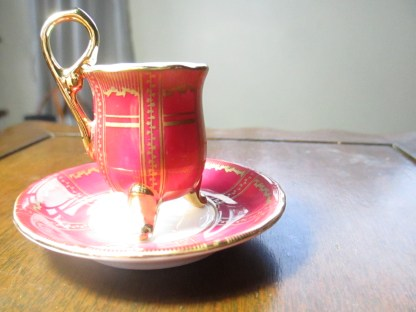 Footed miniature of finest porcelain cup and saucer