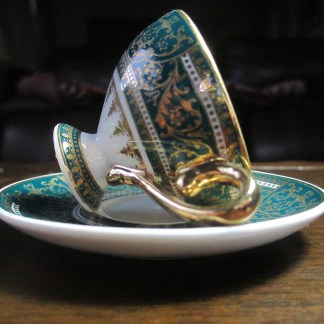 fine porcelain miniature cup and saucer