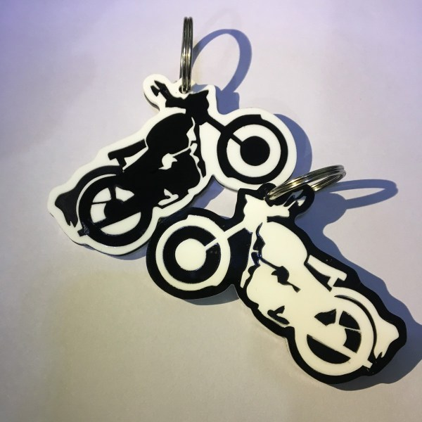 RE Bullet bike shape keychain black and white