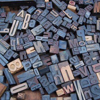 Letter blocks scattered on table
