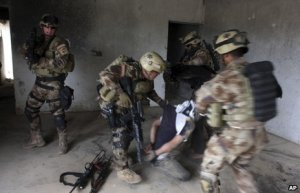Military crack down in Iraq. Image Source