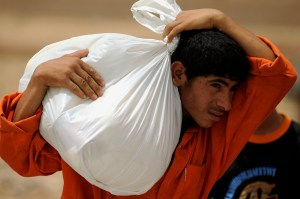 Iraqi Soldiers Distribute 5,000 lbs. of Food and Supplies