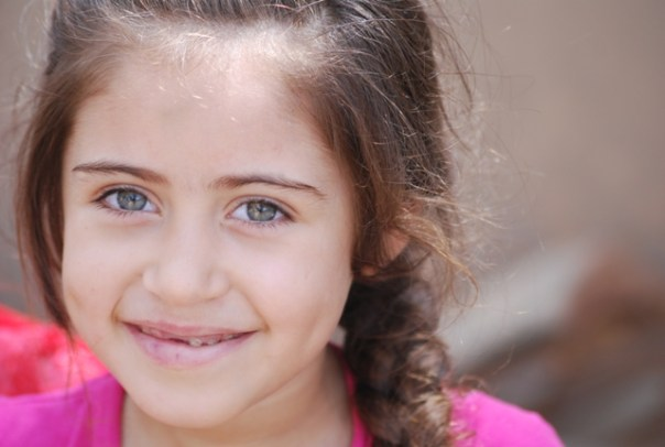 A displaced girl in Babil, Iraq recently reached by Soccer Salam (June 2015).